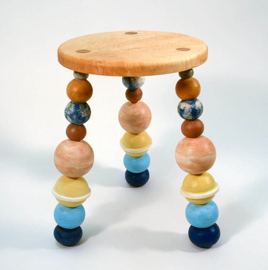 Solar System Stool. Poplar legs, turned on the lathe and hand painted. Birds eye maple seat.